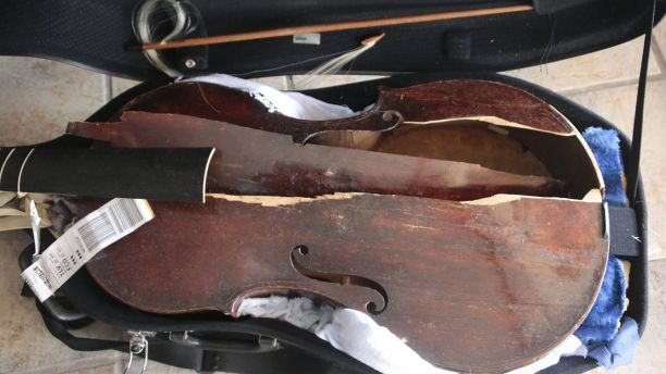 BUSINESS NEWS: American Airlines Passenger Kicked Off Flight After Buying Seat for Her $30,000 Cello